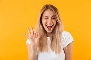 "woman giving the ""OK"" sign for cosmetic dentistry Sugar Land tx and houston cosmetic dentist"