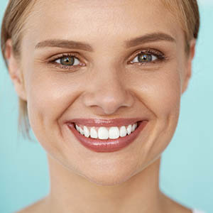 close up of woman smiling to show dental implants from dental implants services sugar land tx