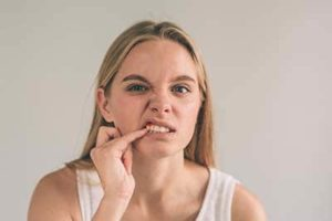 young woman learning she needs gingivitis treatment