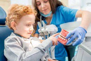 child participates in pediatric dentistry